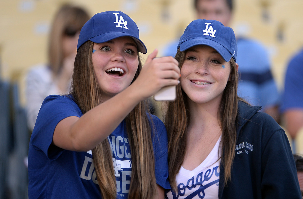 . Los Angeles Dodgers fans take a selfie prior to a Major league baseball game between the San Diego Padres and the Los Angeles Dodgers on Saturday, July 12, 2014 in Los Angeles.   (Keith Birmingham/Pasadena Star-News)