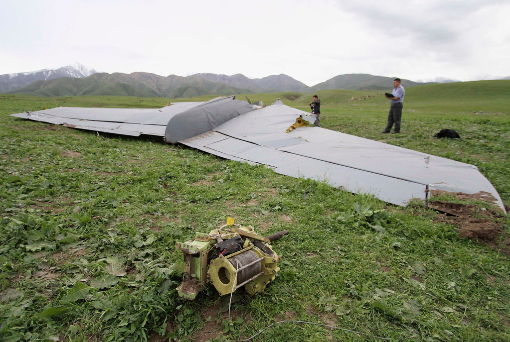 . A view shows the wreckage of the Boeing KC-135 Stratotanker plane near the site of its crash near the Kyrgyz village of Chaldovar, May 3, 2013. REUTERS/Vladimir Pirogov