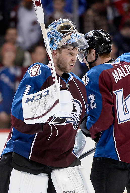 . Colorado goaltender Semyon Varlamov showed some grit as he celebrated the win. (Photo by Karl Gehring/The Denver Post)