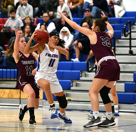 1/10/2020 Mike Orazzi | StaffrTorrington's Suzie Navin (11) and Olivia Smith (32) and St. Paul's Janessa Gonzalez (11) at St. Paul in Bristol Friday night. r