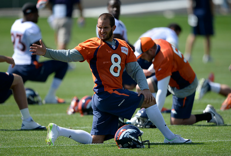 . Denver Broncos kicker Mitch Ewald (8) stretches before practice August 25, 2014 at Dove Valley.(Photo by John Leyba/The Denver Post)