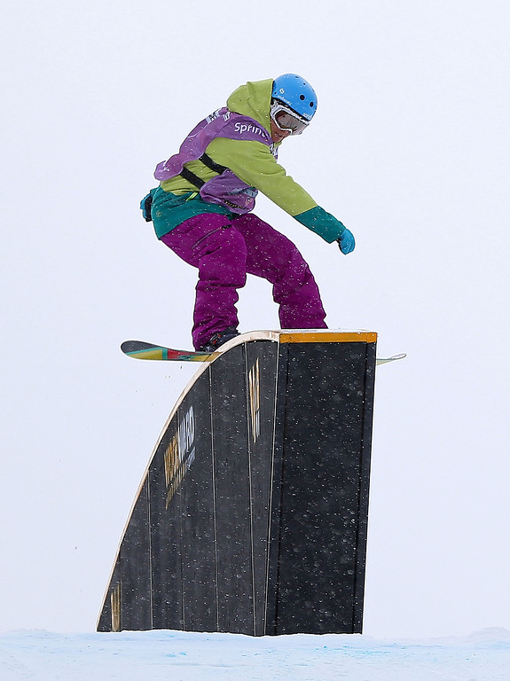 . Molly Milligan of Canada competes during qualifying for the women\'s FIS Snowboard Slopestyle World Cup at U.S. Snowboarding and Freeskiing Grand Prix on December 20, 2013 in Copper Mountain, Colorado.  (Photo by Mike Ehrmann/Getty Images)