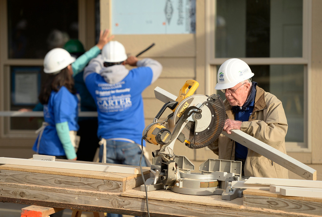 . DENVER, CO - OCTOBER 09: Former president Jimmy Carter works on building a home during Habitat for Humanity\'s Carter Work Project event in the Globeville Neighborhood in Denver, October 09, 2013. Since 1984 the former president and his wife have dedicated a week of their time to help build Habitat homes. (Photo By RJ Sangosti/The Denver Post)