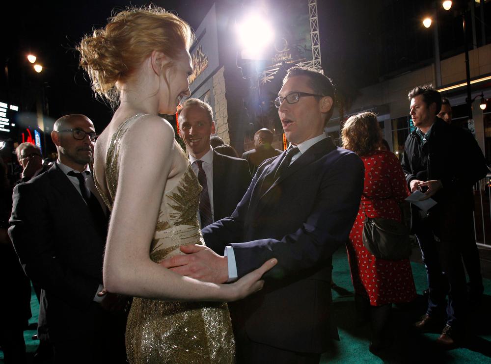 Description of . Director Bryan Singer greets cast member Eleanor Tomlinson (L) at the premiere of