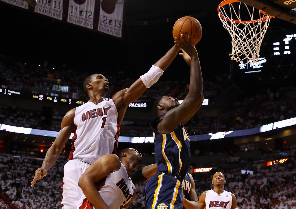 . Chris Bosh #1 of the Miami Heat defends against Roy Hibbert #55 of the Indiana Pacers  during Game Four of the Eastern Conference Finals of the 2014 NBA Playoffs at American Airlines Arena on May 26, 2014 in Miami, Florida.  (Photo by Mike Ehrmann/Getty Images)