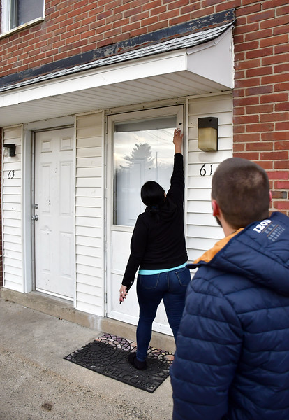 1/14/2020 Mike Orazzi | Staff  Milisabel Cruz-Nieves point to a bullet hole in her Davis Drive home after shots were fired in the area late Monday night.