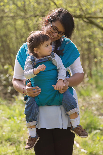 Izmi_Baby_Carrier_Cotton_Teal_Lifestyle_Front_Facing_Carry_Mum_Smiling_With_Daughter.jpg