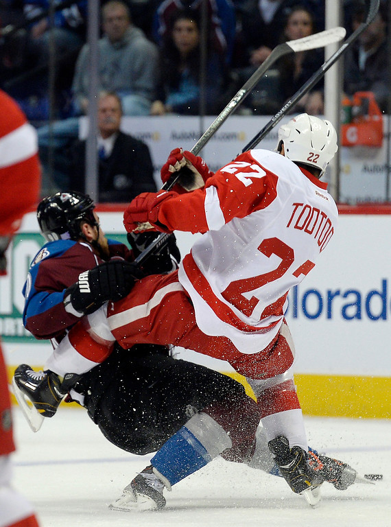 . Detroit Red Wings right wing Jordin Tootoo (22) collides with Colorado Avalanche center Ryan O\'Reilly (90) during the first period October 17, 2013 at Pepsi Center.(Photo by John Leyba/The Denver Post)