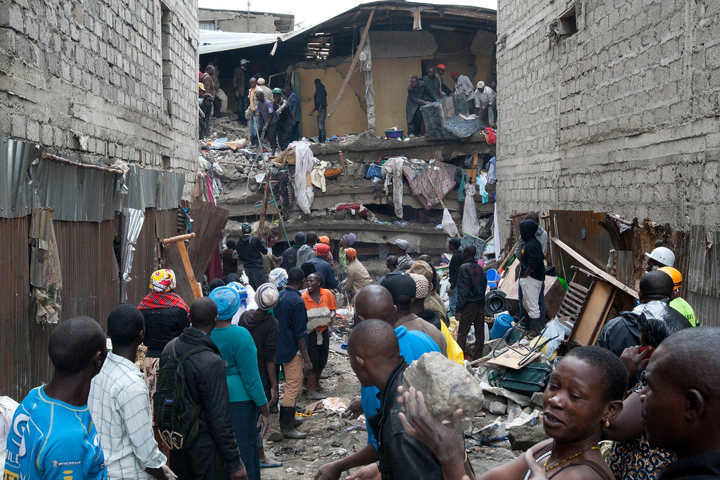 . People help survivors retrieve their household items at the site of a building collapse in Nairobi, Kenya, Saturday, April 30, 2016. (AP Photo/Sayyid Abdul Azim)