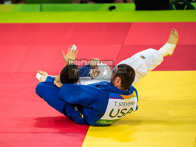 RIO DE JANEIRO, BRAZIL, AUGUST 09:  Travis Stevens of the United States (blue) strangles Avtandili Tchrikishvili of Georgia into submission with his left hand to reach the u81kg final during day 4 of the 2016 Rio Olympic Judo on Tuesday, August 09 at the Carioca Arenas, Barra, Rio de Janeiro, Brazil. (Photo © by David Finch. All rights reserved. Including image always credited to David Finch)Travis Stevens;Avtandili Tchrikishvili