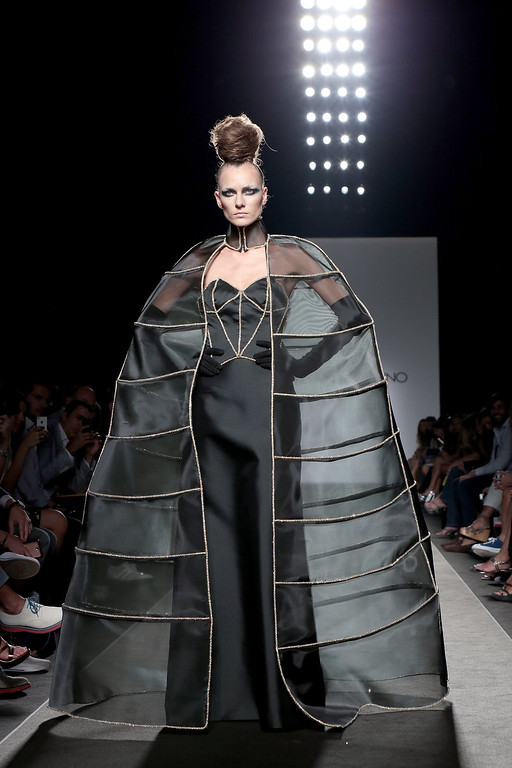 . A model walks the runway during Sabrina Persechino F/W 2013-2014 Haute Couture collection fashion show as part of AltaRoma AltaModa Fashion Week at Santo Spirito In Sassia on July 9, 2013 in Rome, Italy.  (Photo by Elisabetta Villa/Getty Images)