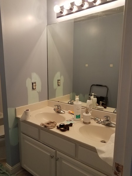 more bathroom before with paint swatches on the wall