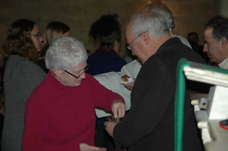 Dr. Mary Hughes, left, Trinity Lutheran Seminary, Columbus, Ohio, takes communion Jan. 11 at the Lutheran Church of the Redeemer, Jerusalem.  Serving is Bishop Craig Johnson, ELCA Minneapolis Area Synod.