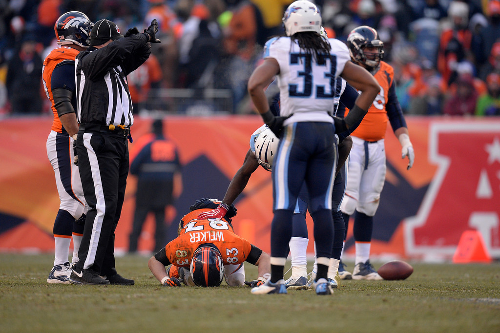. DENVER, CO - DECEMBER 08: Denver Broncos wide receiver Wes Welker (83) lays on the field after getting a concussion in the second quarter. The Denver Broncos take on the Tennessee Titans at Sports Authority Field at Mile High in Denver on December 8, 2013. (Photo by John Leyba/The Denver Post)