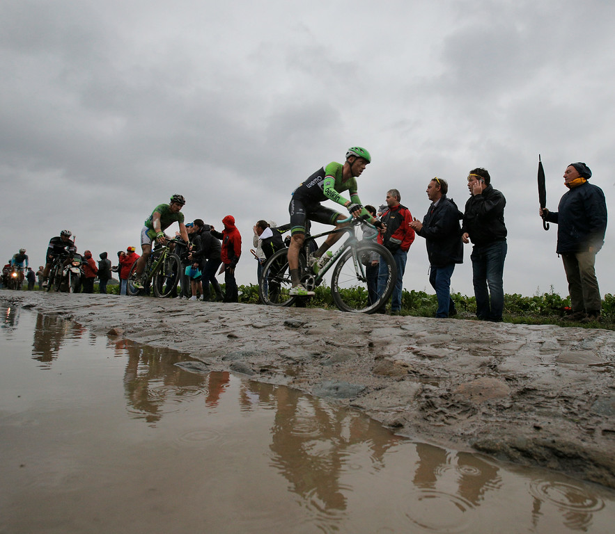 . Stage winner Lars Boom of The Netherlands, right, and Peter Sagan of Slovakia, left, pass over a cobblestone sector during the fifth stage of the Tour de France cycling race over 155 kilometers (96.3 miles) with start in Ypres, Belgium, and finish in Arenberg, France, Wednesday, July 9, 2014. (AP Photo/Christophe Ena)