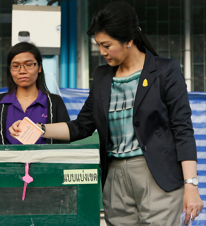 . Thai Prime Minister and Pheu Thai party leader Yingluck Shinawatra casts her ballot for the general election at a polling station in Bangkok, Thailand, Sunday, Feb. 2, 2014. (AP Photo/Wally Santana)