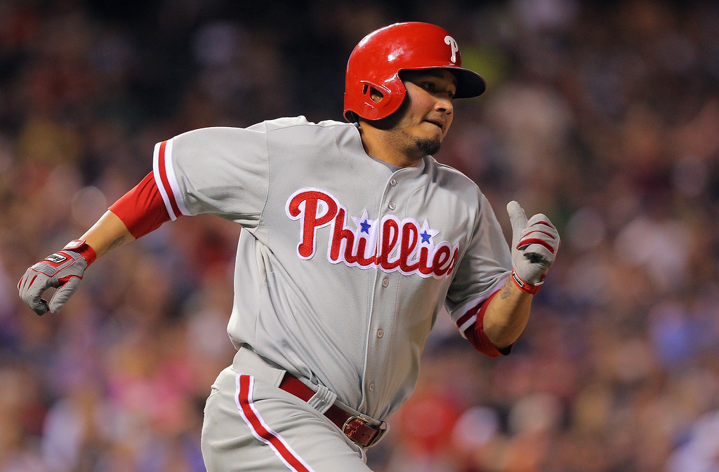 . DENVER, CO - JUNE 14:  Freddy Galvis #13 of the Philadelphia Phillies rounds the bases on a two RBI triple off of Wilton Lopez #59 of the Colorado Rockies to tie the score 7-7 in the seventh inning at Coors Field on June 14, 2013 in Denver, Colorado.  (Photo by Doug Pensinger/Getty Images)