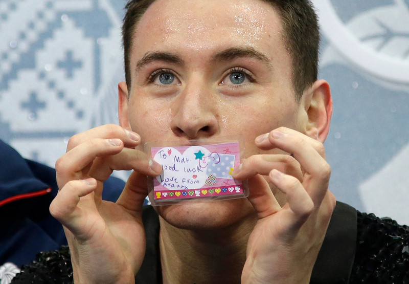 ". Britain\'s Matthew Parr waits for the results with his team in the ""Kiss and Cry\"" zone after competing in the Men\'s Figure Skating Team Short Program at the Iceberg Skating Palace during the Sochi Winter Olympics on February 6, 2014.  (DARRON CUMMINGS/AFP/Getty Images)"