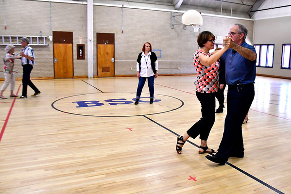 9/27/2018 Mike Orazzi | Staff Ken Brintle leads Beata Czaj-Skarba during ballroom dance lessons at the Bristol Senior Center Thursday afternoon.