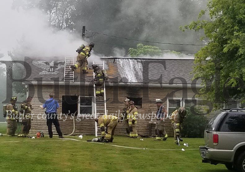 Jim Smith photoFirefighters battle a blaze that broke out Monday morning at a house on North Road in Franklin Township. One one was injured in the fire that authorities believes was electrical in nature. Damage was estimated at $45,000 to $50,000.