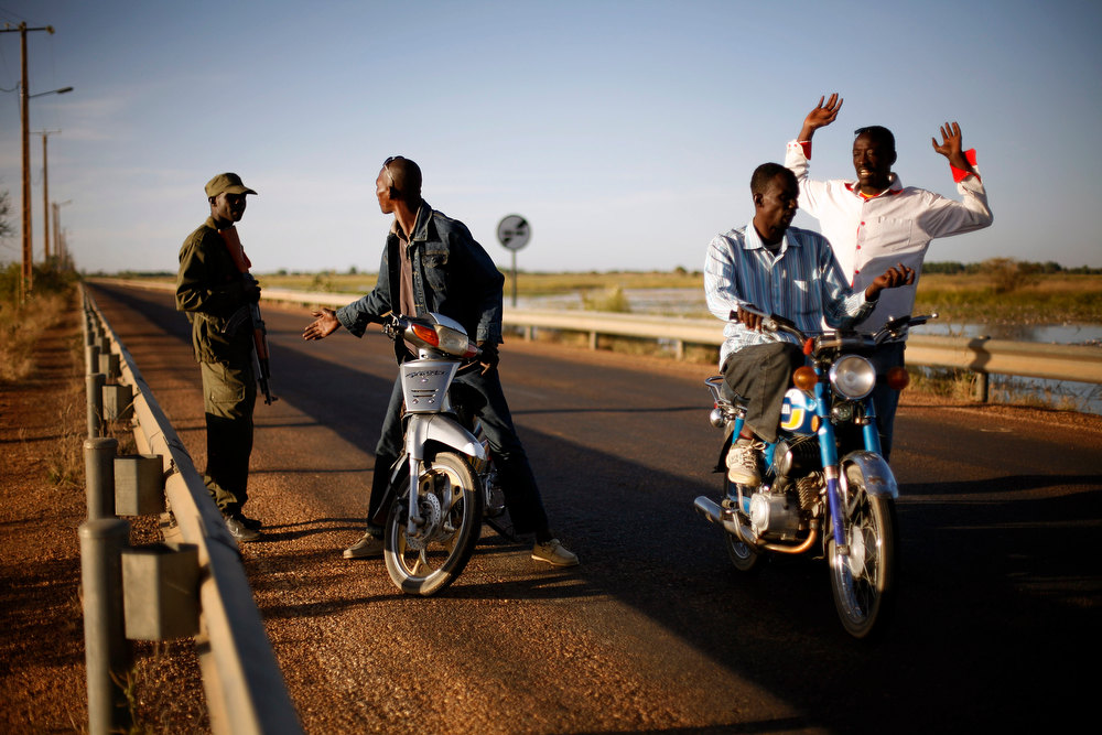 . Malian soldiers man a checkpoint on the banks of the Niger river outside Gao, northern Mali, Thursday, Feb. 7, 2013. French troops began to withdraw from Timbuktu Thursday after securing the fabled city as they ramped up their mission in another northern Mali city, searching for Islamic extremists who may be mixing among the local population. (AP Photo/Jerome Delay)