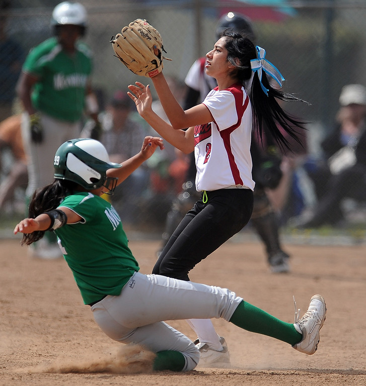 . Monrovia\'s Galvan Tanya safe at third base on a triple as Covina third baseman Amber Medrano waits for the ball in the third inning of the Northview Tournament championship softball game at Northview High School on Thursday, April 4, 2013 in Covina, Calif.  Monrovia won 6-0. 
