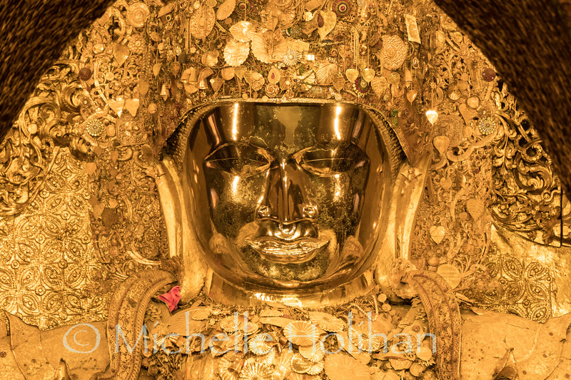 Mahamuni Buddha Statue, the most sacred Buddha statue in Myanmar at the Mahamuni Temple in Mandalay.