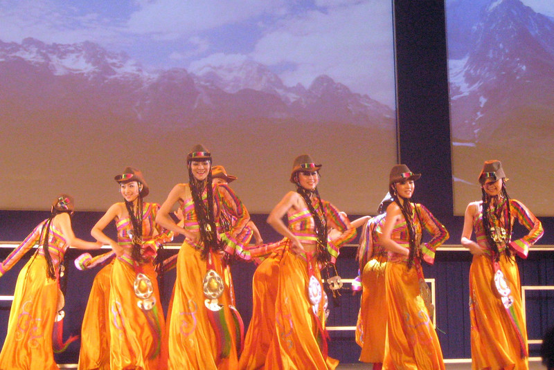 """An """"authentic"""" rendition of a Tibetan folk dance ... what with the smiles, cowboy music and outfits, it seemed to come from Tibet via Beijing via Aaron Copeland and Agnes DeMille."""