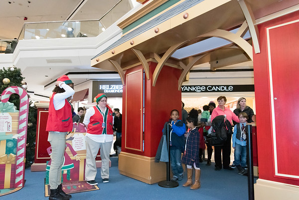 11/23/18 Wesley Bunnell   Staff Santa's Helpers Jasnelys Torres and Valerie Chapman wait for Santa to return from feeding his reindeer to let children including Jeziah Douet, age 7, and Esther Reyes, age 4, enter his workshop on Black Friday at the Westfarms Mall.