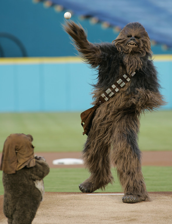 . Chewbacca of Star Wars fame throws out the ceremonial first pitch as Wicket the Ewok looks on before a baseball game between the Florida Marlins and the Washington Nationals Tuesday, Aug. 22, 2006, at Dolphin Stadium in Miami. (AP Photo/Wilfredo Lee)