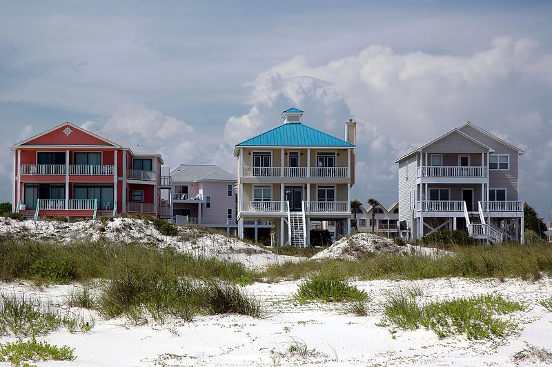 Beach cottages with thunderheads in the distance.