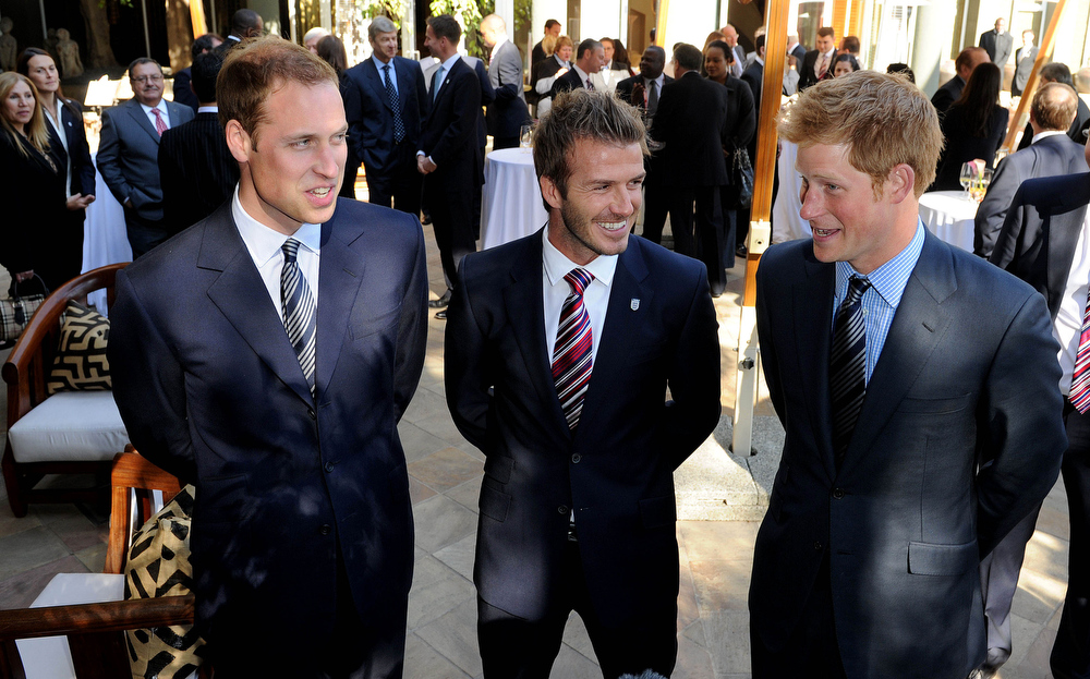 . Prince William  speaks to David Beckham (C) and Prince Harry (R) at an FA reception at the Saxon Hotel on June 19, 2010 in Johannesberg, South Africa. (Photo by Luca Ghidoni - Pool/Getty Images)