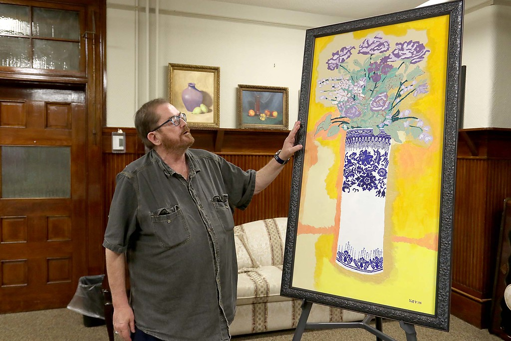 . Artist Kevin McCarthy, 62, of Fitchburg had an art show of some of his work this week at the Fitchburg Senior Center. McCarthy talks about one of his pieces in the show. SENTINEL & ENTERPRISE/JOHN LOVE