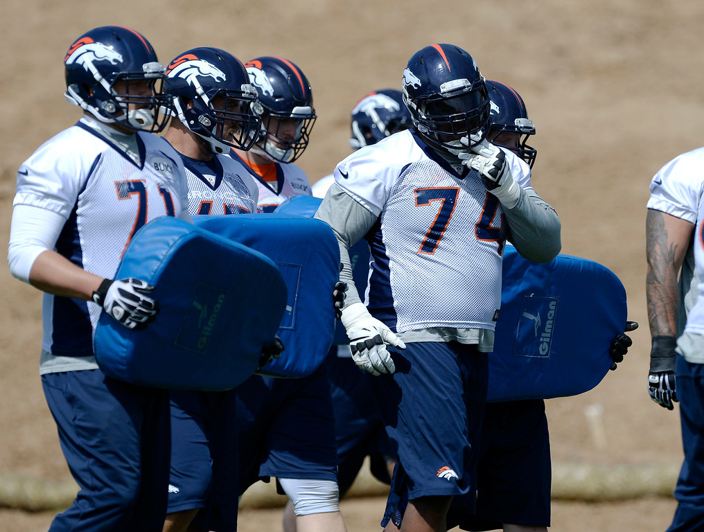 . Denver Broncos G Orlando Franklin (74) runs through drills during OTAs June 16, 2014 at Dove Valley. (Photo by John Leyba/The Denver Post)