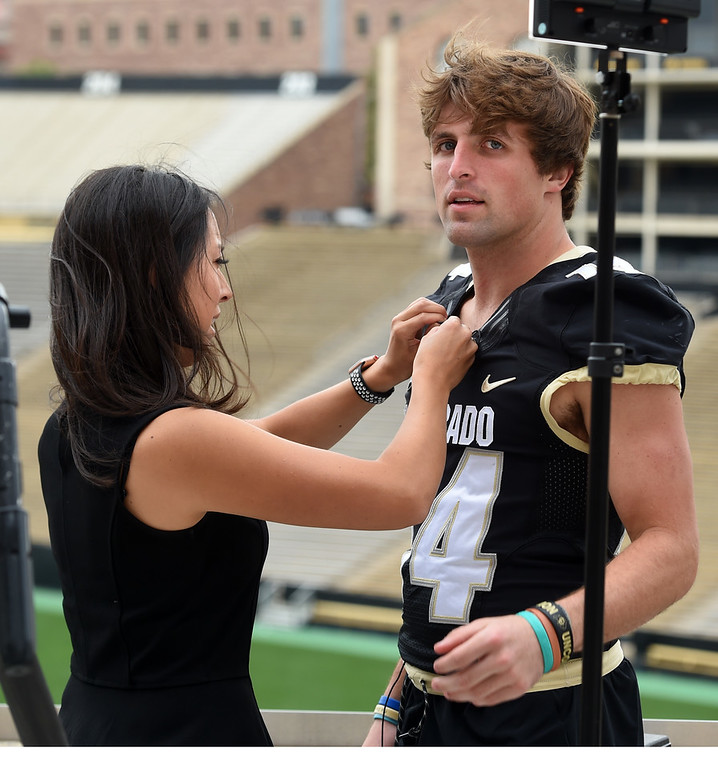 . Taylor Temby, of 9News, hooks up Jay MacIntyre, during CU football and Fall sports media day. For more photos, go to dailycamera.com. Cliff Grassmick  Staff Photographer  August 4, 2018