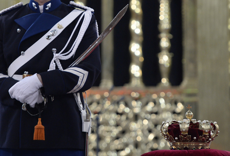 . A guard stands guard by the crown laid on a velvet cushion inside the Nieuwe Kerk (New Church) in Amsterdam on April 30, 2013 during the last preparations for the inauguration of King Willem-Alexander of the Netherlands.  ROBIN UTRECHT/AFP/Getty Images