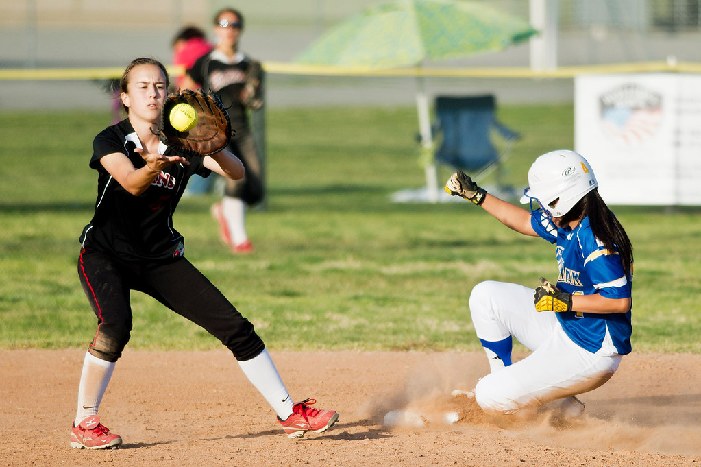 . Charter Oak\'s Nicki Sprague (4) slides safe to second base before Glendora\'s Hailey Mollno (5) in the third inning during San Dimas Softball tournament game, Glendora vs. Charter Oak at Charter Oak High School in Covina on Monday, March 4, 2013. Charter Oak beat Glendora 9-1. (SGVN/Staff photo by Watchara Phomicinda)