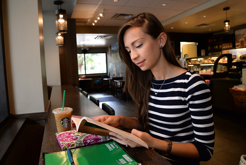 a-student-catches-up-on-her-summer-reading-at-the-on-campus-starbucks_14265435540_o.jpg