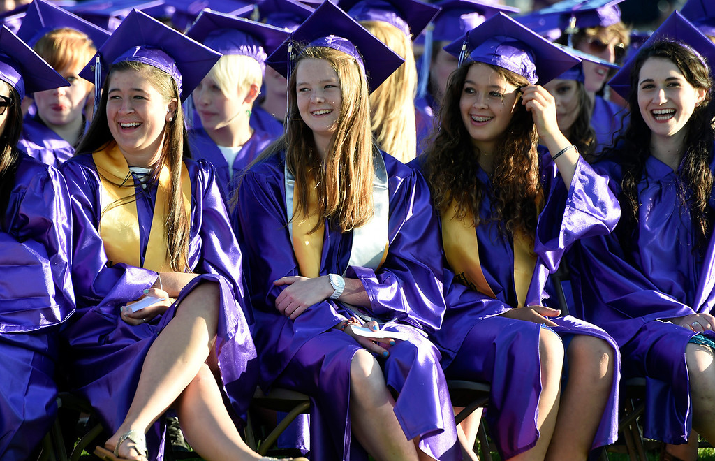 . Kayla Rice/Reformer Graduating seniors (L-R) Jenn Hutton, Anna Gaskill, Molly Gurney and Maya Stoller laugh during a speech at the BUHS graduation cermony on Friday evening.