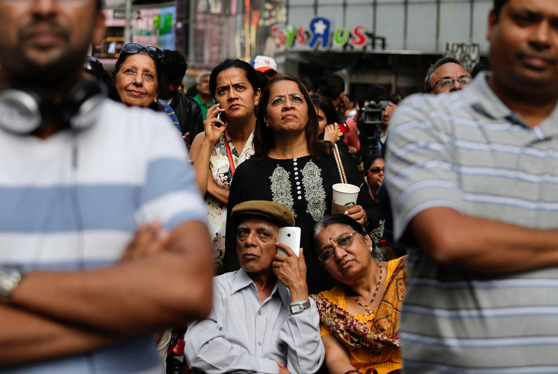 . Members of the Indian-American community gather in Times Square to watch a live stream of Indian Prime Minister Narendra Modi speaking to a capacity crowd at Madison Square Garden, Sunday, Sept. 28, 2014, in New York. A day after addressing a hushed U.N. General Assembly, where headphone-wearing delegates rarely break into a smile, India\'s new prime minister told a packed and boisterous crowd to help him develop his nation\'s economy, vowing that under his leadership, India won\'t look back. (AP Photo/Julie Jacobson)