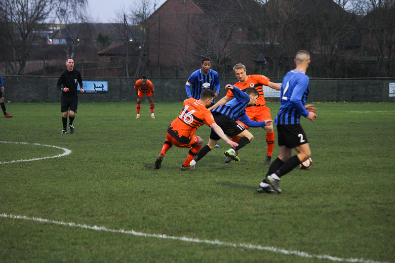 Jammy Lloyd pushes past the Stourport defence 260120PN7-3