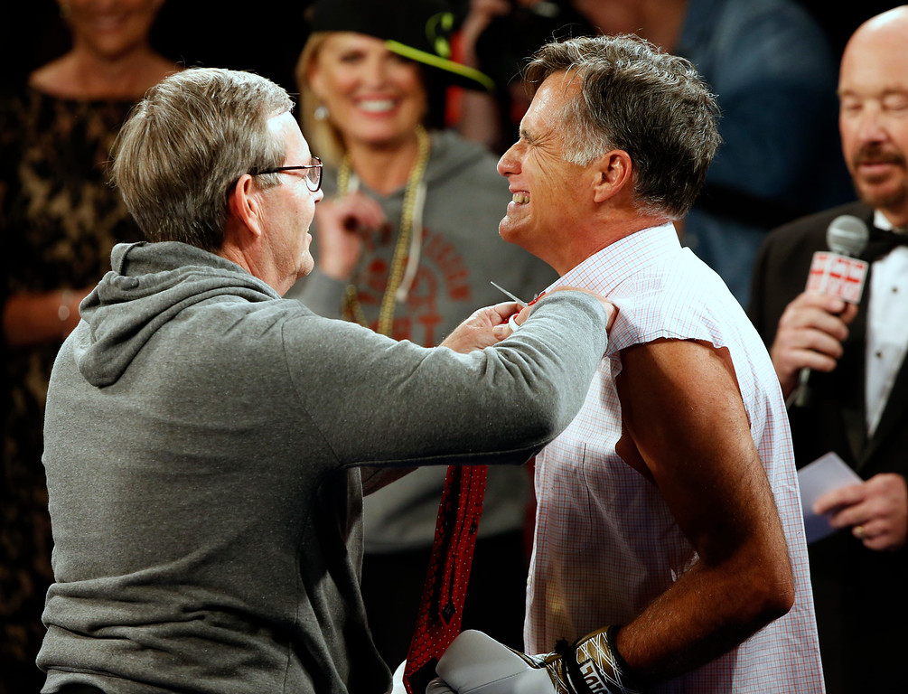 ". Mitt Romney has his tie cut off of him before a fight with Evander Holyfield in a charity boxing event on May 15, 2015 in Salt Lake City, Utah. The event was held to raise money for  ""Charity Vision\"" a charity that aims to restore sight to the blind and visually impaired. (Photo by George Frey/Getty Images)"