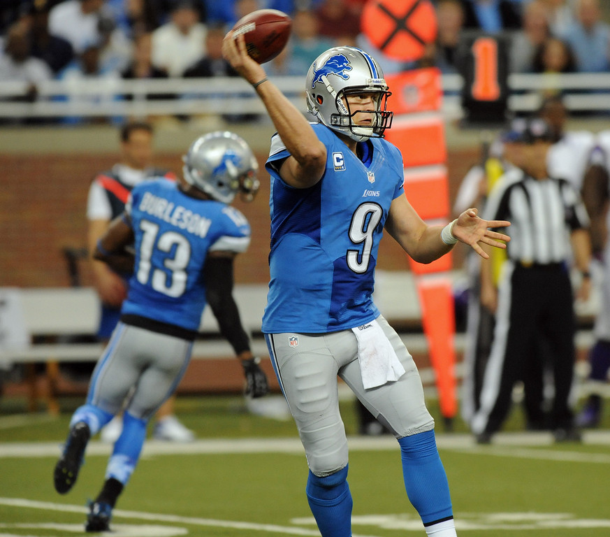 . Detroit Lions quarterback Matthew Stafford passes against the Minnesota Vikings during fourth quarter action.  The Vikings beat the Lions 20-13.  Photo taken on Sunday, September 30, 2012, at Ford Field in Detroit, Mich.  (Special to The Oakland Press/Jose Juarez)