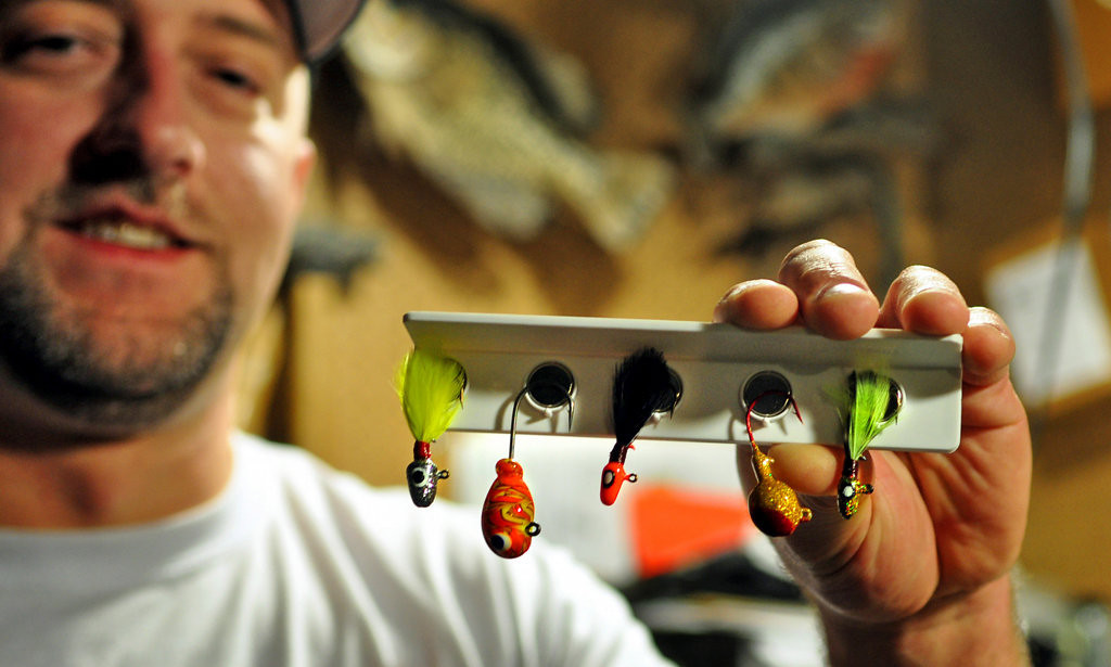 ". Brad Yaritz displays a selection of lead-free jigs he sells on his website, CatchItOutdoors.com, in the basement of his White Bear Lake home Wednesday, Jan. 23, 2014. Yaritz made several of these jigs, made of glass and tin, for Eco-Jigs, the company he founded. ""I catch tons of fish,\"" says Yaritz, who uses the lures in walleye fishing tournaments. (Pioneer Press Dave Orrick)"