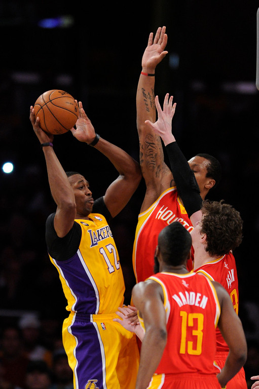 . Lakers#12 Dwight Howard drives to the hoop against a host of Rockets in the first quarter. The Lakers faced the Houston Rockets in the final home game of the year at Staples Center in Los Angeles, CA 4/17/2013(John McCoy/Staff PhotographerThe Lakers faced the Houston Rockets in the final home game of the year at Staples Center in Los Angeles, CA 4/17/2013(John McCoy/Staff Photographer