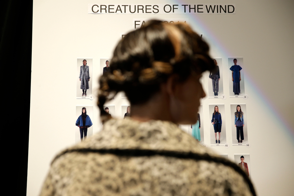 . A board displaying the looks for the Fall 2014 Creatures of the Wind collection is displayed backstage during Fashion Week in New York, Thursday, Feb. 6, 2014.  (AP Photo/Seth Wenig)