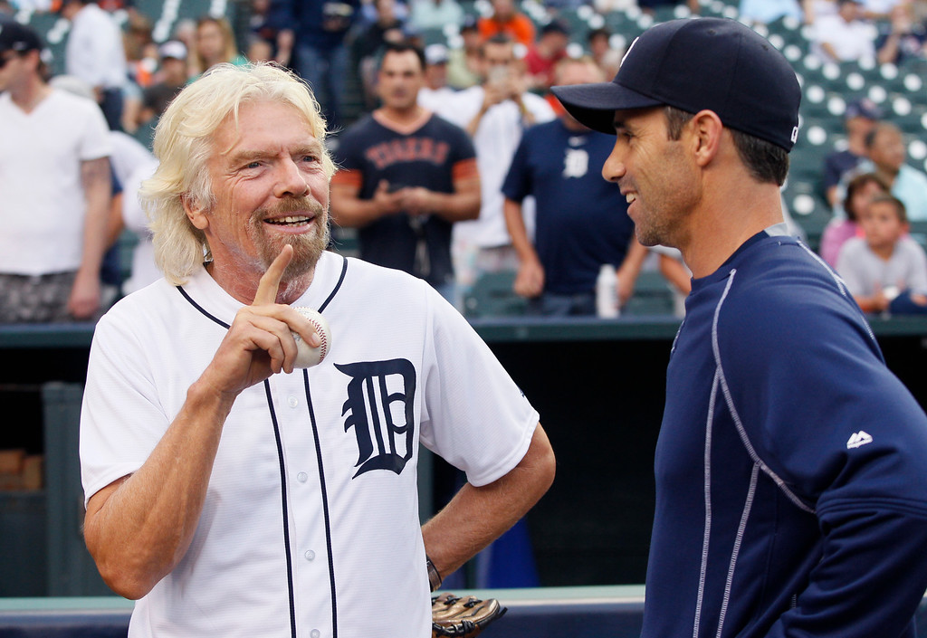 . Sir Richard Branson, president and founder of Virgin Atlantic, talks with Detroit Tigers manager Brad Ausmus before the Tigers game against the Cleveland Indians at Comerica Park Friday, June 12, 2015, in Detroit. Branson was in town to kick off Virgin Atlantic Airlines new route from Detroit to London. (AP Photo/Duane Burleson)