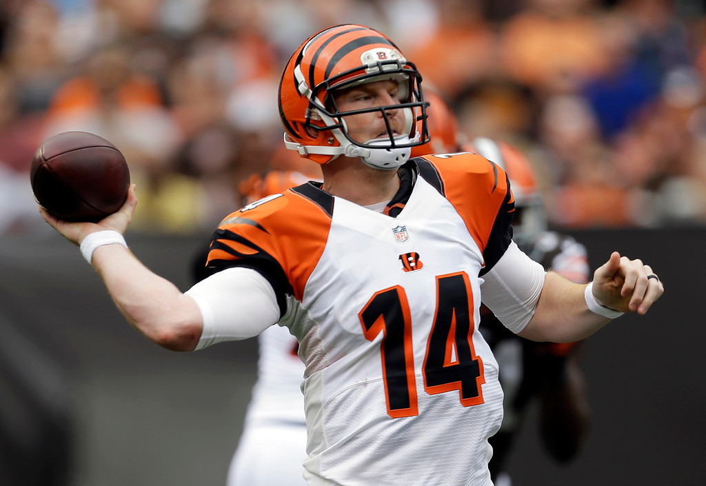 . Cincinnati Bengals quarterback Andy Dalton passes in the third quarter of an NFL football game against the Cleveland Browns, Sunday, Sept. 29, 2013, in Cleveland. (AP Photo/Tony Dejak)