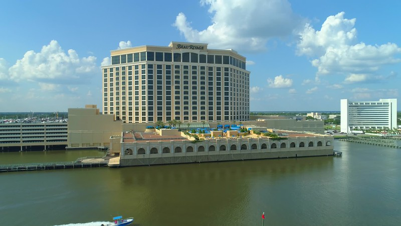 Aerial video Beau Rivage pool deck reveal with crowds people tourists