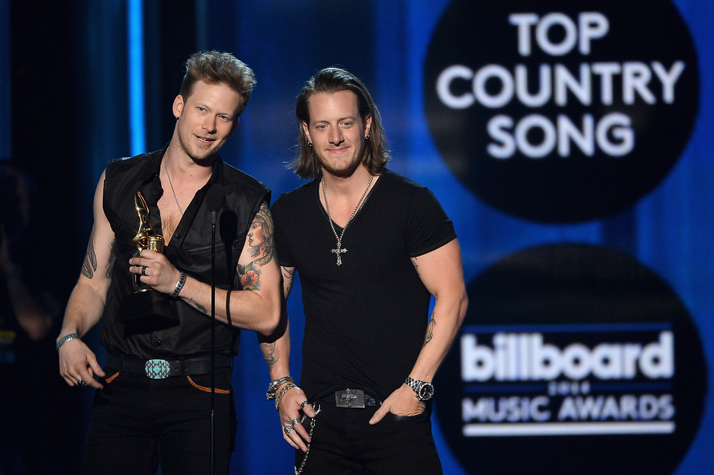 . Recording artists Brian Kelley (L) and Tyler Hubbard of Florida Georgia Line accept the Top Country Song for \'Cruise\' onstage during the 2014 Billboard Music Awards at the MGM Grand Garden Arena on May 18, 2014 in Las Vegas, Nevada.  (Photo by Ethan Miller/Getty Images)
